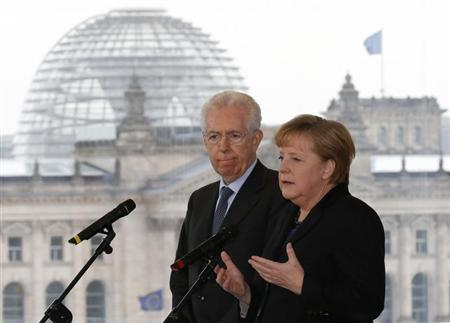 German Chancellor Angela Merkel and Italian Prime Minister Mario Monti arrive for a statement to the media before talks in Berlin January 31, 2013. REUTERS/Tobias Schwarz