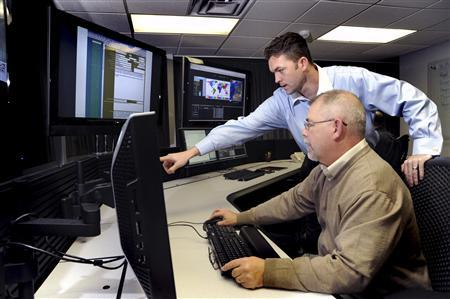 U.S. Department of Homeland Security (DHS) employees work on the Industrial Control Systems Cyber Emergency Response Team (ICS-CERT) operational watch floor where they monitor, track, and investigate cyber incidents in this handout photo taken October 29, 2009 at the Idaho National Laboratory in Idaho Falls, Idaho. REUTERS/Chris Morgan/Idaho National Laboratory