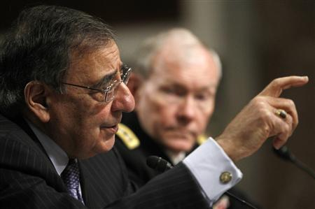 U.S. Secretary of Defense Leon Panetta (L) and U.S. Army General Martin Dempsey, the Chairman of the Joint Chiefs of Staff, testify on the Defense Department's response on the attack on U.S. facilities in Benghazi, Libya before the Senate Armed Services Committee hearing in Washington February 7, 2013. REUTERS/Gary Cameron