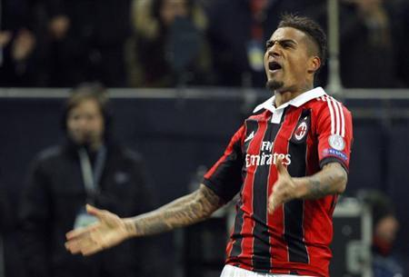 AC Milan's Kevin-Prince Boateng reacts after scoring against Barcelona during their Champions League soccer match at the San Siro stadium in Milan February 20, 2013. REUTERS/Alessandro Garofalo