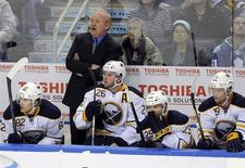 Buffalo Sabres coach Lindy Ruff watches from the bench during the second period of their NHL hockey game against the Toronto Maple Leafs in Buffalo, New York January 29, 2013. REUTERS/Doug Benz