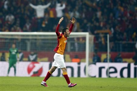 Galatasaray's Burak Yilmaz celebrates his goal against Schalke 04 during their Champions League soccer match at Turk Telekom Arena in Istanbul February 20, 2013. REUTERS/Murad Sezer