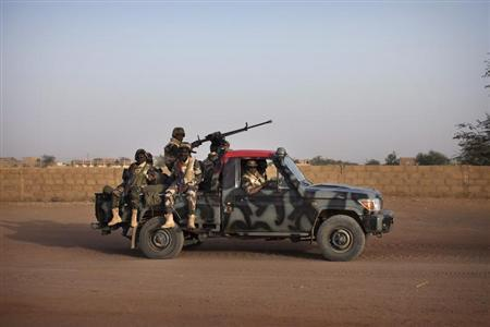 Malian soldiers patrol the streets of Gao February 20, 2013. REUTERS/Joe Penney