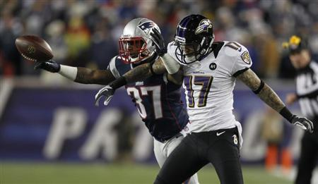 New England Patriots corner back Alfonzo Dennard (L) breaks up a pass intended for Baltimore Ravens wide receiver Tandon Doss during the third quarter in the NFL AFC Championship football game in Foxborough, Massachusetts, January 20, 2013. REUTERS/Jessica Rinaldi