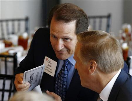 Fluor CEO David Seaton (L) is pictured at a business roundtable meeting of company leaders and U.S. Republican Presidential candidate Mitt Romney in Washington, June 13, 2012. REUTERS/Jason Reed