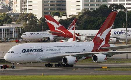 A Qantas A380 arrives at its gate at Kingsford Smith International airport in Sydney June 26, 2009. REUTERS/Daniel Munoz