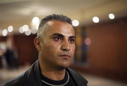 Palestinian journalist Emad Burnat pauses while he speaks to members of the media before a screening of his Oscar-nominated documentary ''5 Broken Cameras'' in the West Bank city of Ramallah January 28, 2013. REUTERS/Mohamad Torokman/Files
