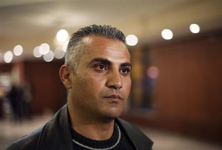 Palestinian journalist Emad Burnat pauses while he speaks to members of the media before a screening of his Oscar-nominated documentary ''5 Broken Cameras'' in the West Bank city of Ramallah January 28, 2013. REUTERS/Mohamad Torokman