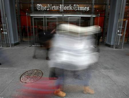 People walk past The New York Times head office in New York, February 7, 2013. REUTERS/Carlo Allegri