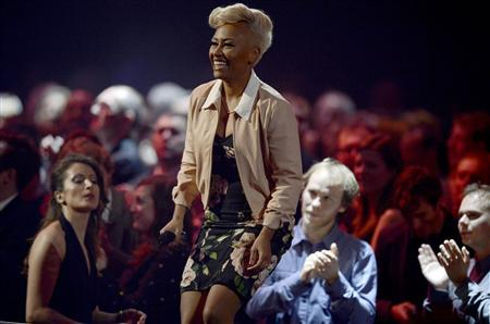 Singer Emeli Sande walks to the stage to be awarded the best British Album award during the BRIT Awards, celebrating British pop music, at the O2 Arena in London February 20, 2013. REUTERS/Dylan Martinez