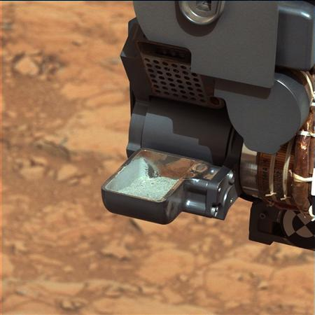 The first sample of powdered rock from Mars extracted by the NASA's Curiosity rover drill is pictured in this February 20, 2013 NASA handout photo. REUTERS/NASA/JPL-Caltech/MSSS/Handout