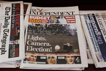 Copies of The Independent newspaper sit among other titles outside a newsagent in Kensington, in west London March 25, 2010. REUTERS/Luke MacGregor