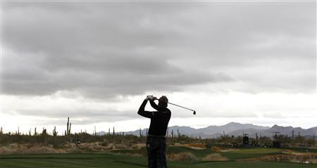 Ian Poulter of England hits off the third tee during the first round of the WGC-Accenture Match Play Championship golf tournament in Marana, Arizona February 20, 2013. REUTERS/Matt Sullivan