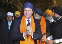Britain's Prime Minister David Cameron visits the holy Sikh shrine of Golden temple in Amritsar February 20, 2013. REUTERS/Munish Sharma