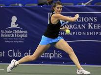 Rebecca Marino of Canada hits a return to Ksenia Pervak of Kazakhstan during their Memphis International women's singles tennis match in Memphis, Tennessee February 21, 2012. REUTERS/Nikki Boertman