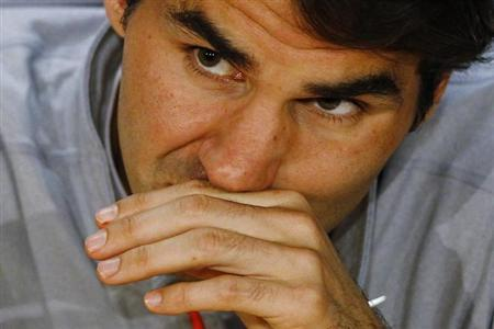 Roger Federer of Switzerland attends a news conference after he was defeated in his men's singles semi-final match by Andy Murray of Britain at the Australian Open tennis tournament in Melbourne January 26, 2013. REUTERS/Navesh Chitrakar/Files