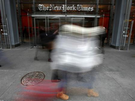 People walk past The New York Times head office in New York, February 7, 2013. REUTERS/Carlo Allegri/Files