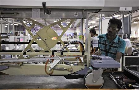A GE Healthcare employee assembles a CT scan table in Bangalore June 21, 2010. REUTERS/Danish Siddiqui/Files