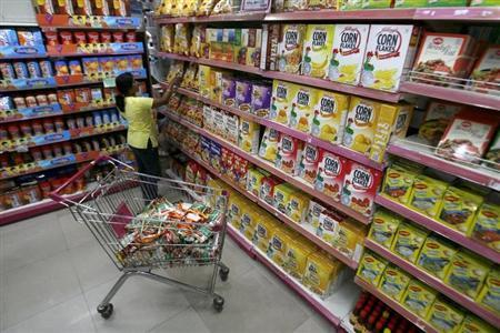 A customer collects food packets at a shopping mall in Siliguri March 14, 2008. REUTERS/Rupak De Chowdhuri/Files