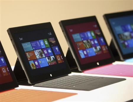 New Surface tablet computers with keyboards are displayed at its unveiling by Microsoft in Los Angeles, California, June 18, 2012. REUTERS/David McNew