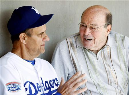 Los Angeles Dodgers head coach Joe Torre (L) talks to Joe Garagiola Sr. before playing the Chicago White Sox in a MLB spring training game in Glendale, Arizona in this March 6, 2010, file photo. REUTERS/Rick Scuteri/Files