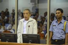 Former Khmer Rouge S-21 prison chief Kaing Guek Eav (L), also known as Duch, stands in a dock as he testifies at the Court Room of the Extraordinary Chambers in the Courts of Cambodia (ECCC) on the outskirts of Phnom Penh March 20, 2012. REUTERS/Nhet Sokheng/ECCC/Handout
