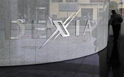 Le groupe Dexia, en cours de démantèlement après sa quasi-nationalisation par les Etats français et belge, affiche une deuxième lourde perte annuelle consécutive, conséquence de cessions d'actifs décotés, de dépréciations et de la hausse de ses coûts de financement. /Photo d'archives/REUTERS/Thierry Roge
