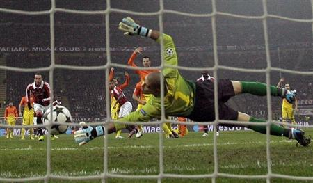 AC Milan's Kevin-Prince Boateng (C) scores as Barcelona's goalkeeper Victor Valdes fails to save during their Champions League soccer match at the San Siro stadium in Milan February 20, 2013. REUTERS/Tony Gentile