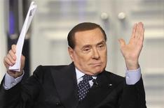 Italy's former Prime Minister Silvio Berlusconi gestures as he appears as a guest on the RAI television show Porta a Porta (Door to Door) in Rome February 20, 2013. REUTERS/Remo Casilli