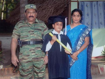 An undated picture supplied by the Sri Lankan Ministry of Defence shows the Liberation Tigers of Tamil Eelam (LTTE) leader, Vellupillai Prabhakaran (L), standing with his wife Mathivathani (R) and his son Balachandran from a collection of photographs that government soldiers said they discovered in a ''hideout'' in northern Sri Lanka. REUTERS/Sri Lankan Ministry of Defence/Handout/Files