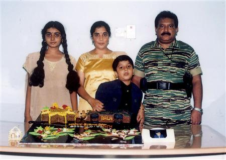 An undated picture supplied by the Sri Lankan Ministry of Defence shows the Liberation Tigers of Tamil Eelam (LTTE) leader Vellupillai Prabhakaran (R) standing with his wife Mathivathani (2nd L), his son Balachandran and his daughter Duwaraka (L) from a collection of photographs that government soldiers said they discovered recently in a ''hideout'' in northern Sri Lanka. REUTERS/Sri Lankan Ministry of Defence/Handout