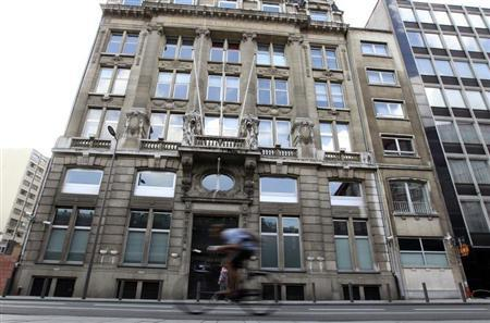 A cyclist rides past Antwerp's Diamond Bourse September 3, 2011. REUTERS/Thierry Roge