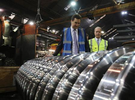 Britain's Chancellor of the Exchequer George Osborne tours a factory of train wheel manufacturers Lucchini UK, at Trafford Park in Manchester, England January 28, 2013. REUTERS/Christopher Furlong/POOL
