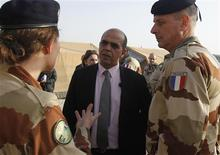 French Minister for Veteran Affairs Kader Arif (C) speaks to members of a French military field hospital at the Al Zaatri refugee camp in the Jordanian city of Mafraq, near the border with Syria, December 25, 2012. REUTERS/Ali Jarekji (JORDAN - Tags: POLITICS CIVIL UNREST) - RTR3BWBZ