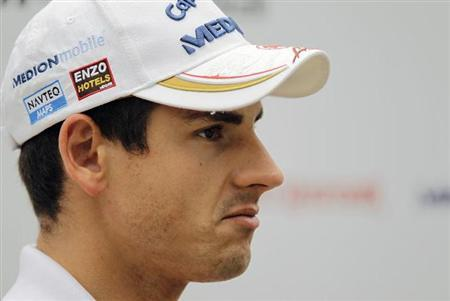 Force India Formula One driver Adrian Sutil of Germany speaks to TV crew at the paddock of the Singapore F1 Grand Prix at the Marina Bay street circuit in Singapore September 22, 2011. REUTERS/Tim Chong/Files