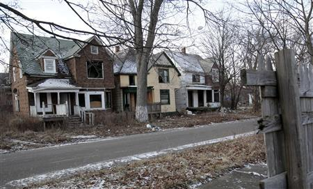 A row of vacant and blighted houses are seen in a once vibrant east side neighborhood in Detroit, Michigan January 22, 2013. REUTERS/Rebecca Cook