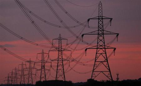 The sun rises behind electricity pylons near Chester, northern England October 24, 2011. REUTERS/Phil Noble