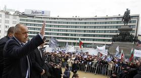 Outgoing Bulgarian Prime Minister Boiko Borisov waves to supporters outside the parliament in Sofia February 21, 2013. REUTERS/Stoyan Nenov
