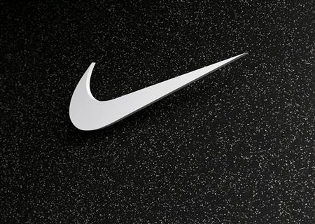 The company logo of Nike is shown at the U.S. Olympic athletics trials in Eugene, Oregon June 21, 2012. REUTERS/Mike Blake (UNITED STATE - Tags: SPORT BUSINESS LOGO) - RTR34HO5