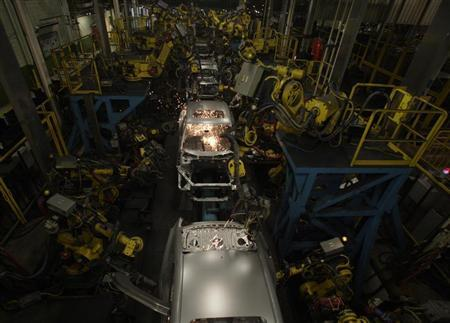 2013 Honda Accord bodies are seen being welded during a tour of the Honda automobile plant in Marysville, Ohio October 11, 2012. REUTERS/Paul Vernon