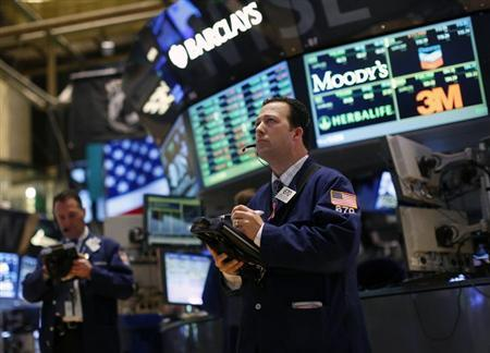 Traders work on the floor of the New York Stock Exchange, February 19, 2013. REUTERS/Brendan McDermid