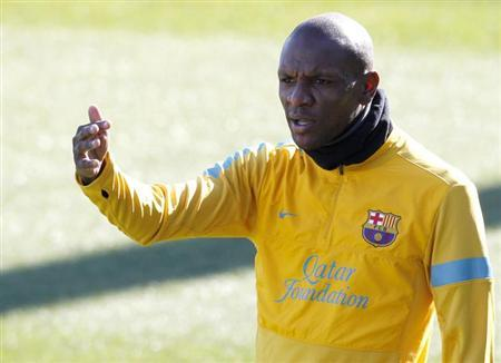 Barcelona's Eric Abidal gestures to his team mates during a training session at Ciutat Esportiva Joan Gamper in Sant Joan Despi near Barcelona February 13, 2013. REUTERS/Gustau Nacarino