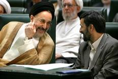 Iran's new President Ahmadinejad talks to former president Khatami before taking oath of office during swearing-in ceremony in Tehran. REUTERS/Morteza Nikoubazl