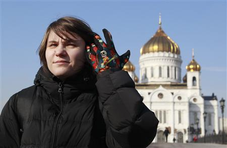 Yekaterina Samutsevich, a member of punk group Pussy Riot, looks on during an interview in front of the Christ the Saviour Cathedral in Moscow, February 21, 2013. REUTERS/Sergei Karpukhin