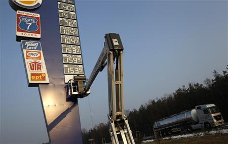 A petrol station employee changes letters and names including the new ethanol E10 fuel on the price board at a highway service station in Soltau between Hamburg and Hanover March 1, 2011. REUTERS/Christian Charisius