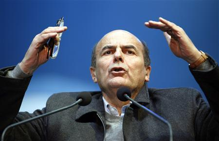 Italy's Democratic Party (PD) leader Pier Luigi Bersani gestures as talks during a political rally in downtown Milan February 17, 2013. REUTERS/Alessandro Garofalo
