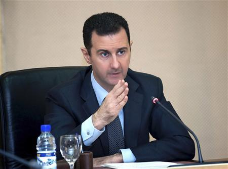 Syria's President Bashar al-Assad heads a cabinet meeting in Damascus, in this handout photograph distributed by Syria's national news agency SANA on February 12, 2013. REUTERS/SANA/Handout