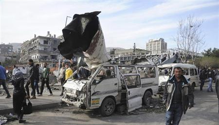 A general view of the destruction after an explosion in central Damascus February 21, 2013, in this handout photograph released by Syria's national news agency SANA. A car bomb killed 53 people and wounded 200 in central Damascus on Thursday when it blew up on a busy highway close to ruling Baath Party offices and the Russian Embassy, Syrian television said. REUTERS/Sana (SYRIA - Tags: CONFLICT POLITICS CIVIL UNREST) ATTENTION EDITORS - THIS PICTURE WAS PROVIDED BY A THIRD PARTY. REUTERS IS UNABLE TO INDEPENDENTLY VERIFY THE AUTHENTICITY, CONTENT, LOCATION OR DATE OF THIS IMAGE. FOR EDITORIAL USE ONLY. NOT FOR SALE FOR MARKETING OR ADVERTISING CAMPAIGNS. THIS PICTURE IS DISTRIBUTED EXACTLY AS RECEIVED BY REUTERS, AS A SERVICE TO CLIENTS