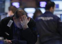 A trader works on the floor of the New York Stock Exchange February 21, 2013. REUTERS/Brendan McDermid (UNITED STATES - Tags: BUSINESS)