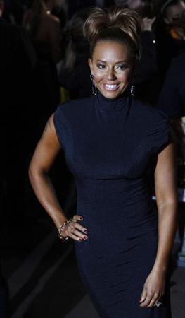 Singer and former Spice Girl, Mel B, poses for photographers as she arrives for the European premiere of ''The Hunger Games'' at the O2 Arena in London March 14, 2012. REUTERS/Luke MacGregor